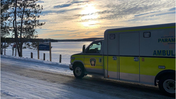 Ambulance parked by a lake