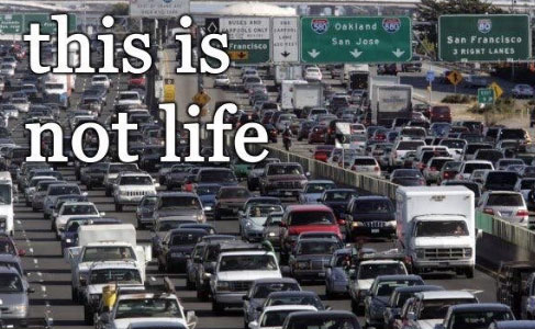 traffic jam with the text this is not life written on top