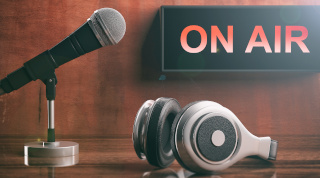 """On Air"" sign with headphones and microphone"